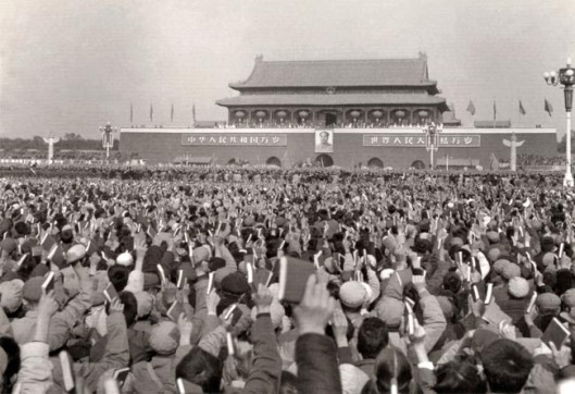 Large communist rally of Red Guards waving Little Red Books of Quotations of Chairman Mao Zedong during Great Proletarian Cultural Revolution, at Tian An Men Square in 1966.